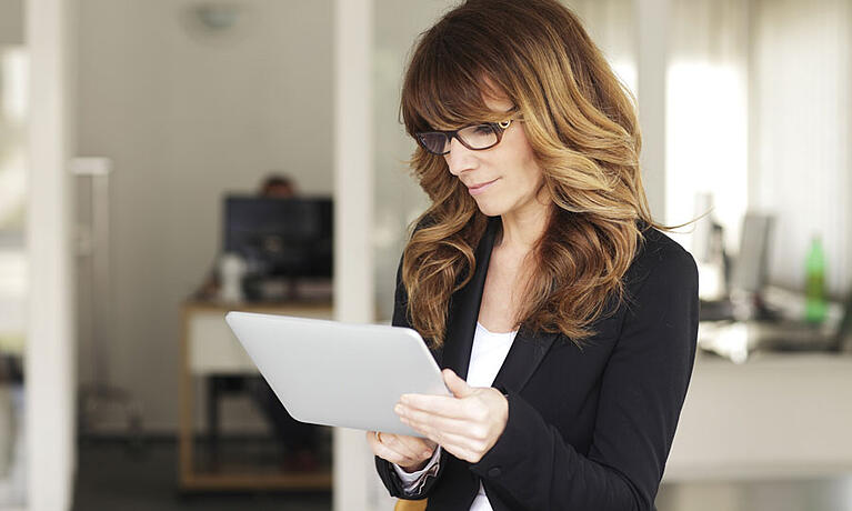 woman using tablet to access business documents